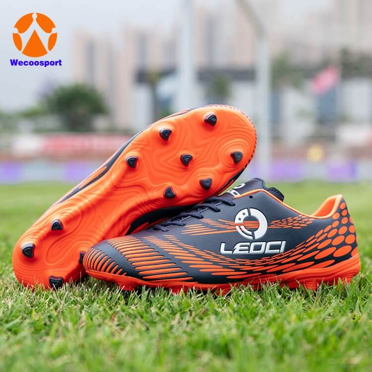 boy orange soccer shoes for kids