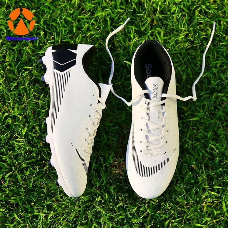 white firm ground soccer shoes