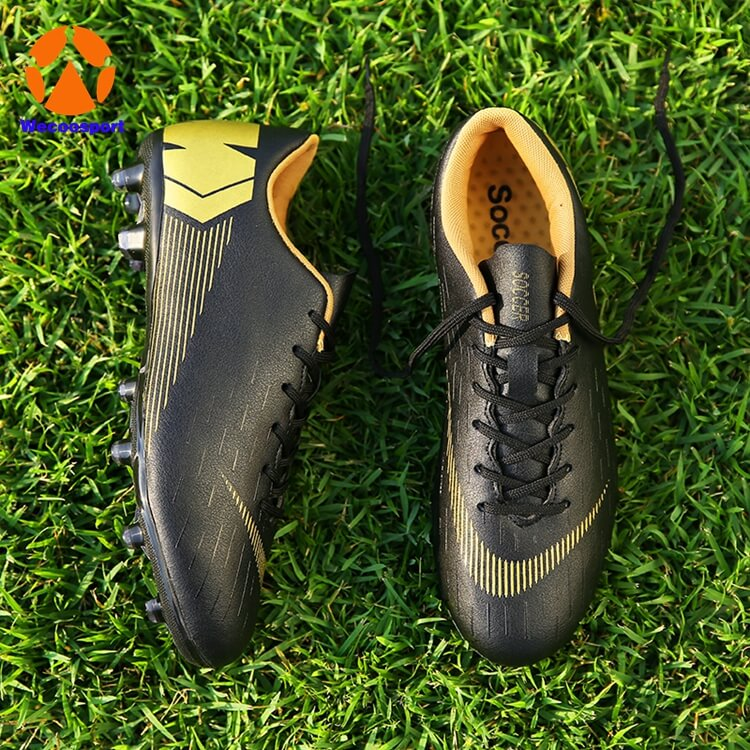 black firm ground soccer shoes